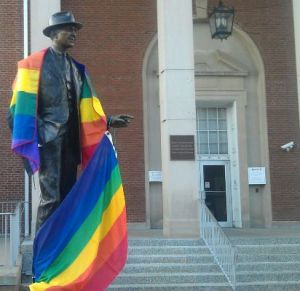 Jimmy Stewart statue draped in rainbow flag